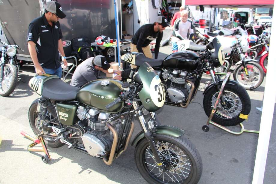 Triumph motorcycles waiting for track time.