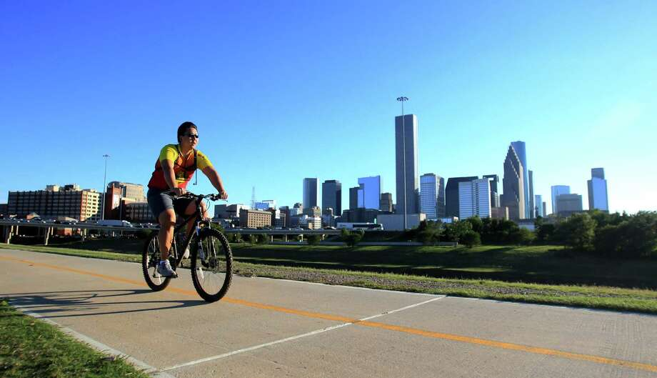 A cyclist use the Heights Bike Trail along the Buffalo Bayou last fall. Voters in 2012 approved $100 million to create 150 miles of trails via the Bayou Greenways 2020 project. Photo: Mayra Beltran, Staff / © 2013 Houston Chronicle