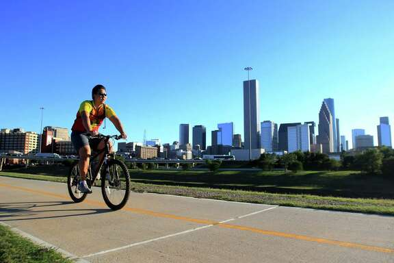 A cyclist use the Heights Bike Trail along the Buffalo Bayou last fall. Voters in 2012 approved $100 million to create 150 miles of trails via the Bayou Greenways 2020 project.