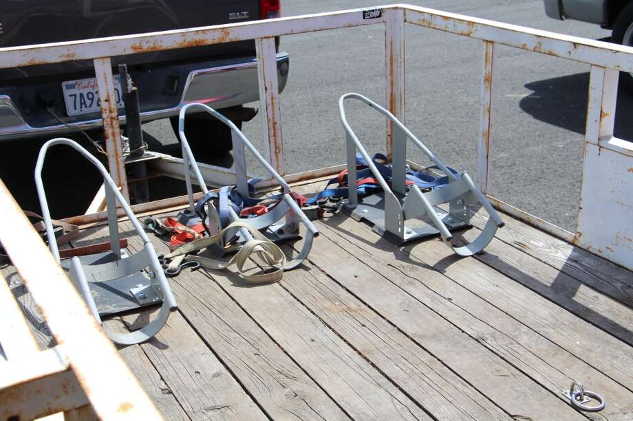 Chocks hold the front wheels of motorcycles in the trailer bed.