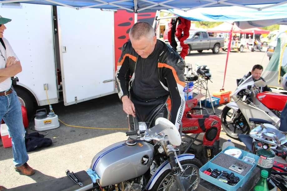 Neil Jensen works on his Honda CL175.