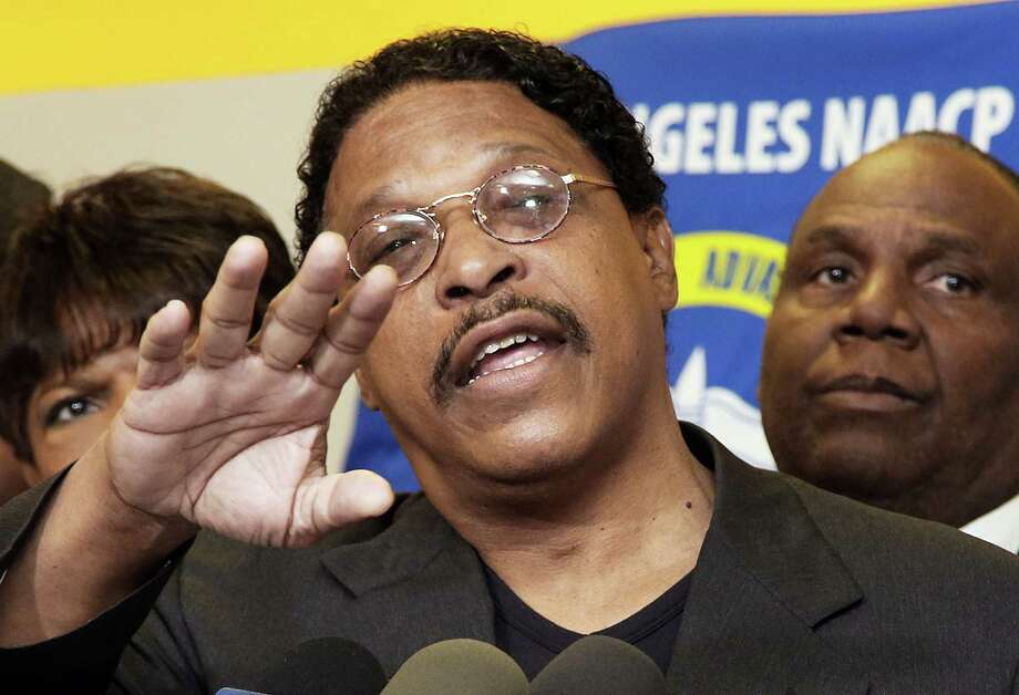 Los Angeles NAACP chapter president Leon Jenkins announces Monday that the group was rescinding Donald Sterling award for promoting civil rights. Photo: Nick Ut, STF / AP