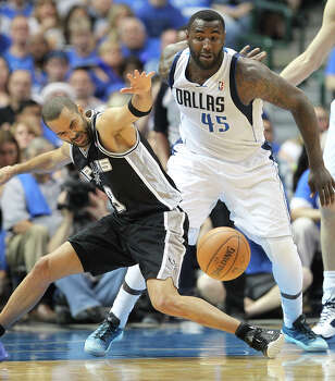 San Antonio Spurs' Tony Parker loses the ball as Dallas Mavericks' DeJuan Blair defends during the first half of game six in the first round of the Western Conference Playoffs at the American Airlines Center in Dallas, Friday, May 2, 2014. Photo: Jerry Lara, San Antonio Express-News / ©2014 San Antonio Express-News