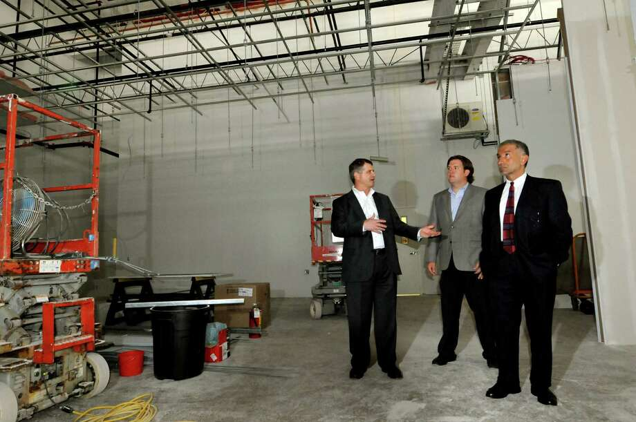 Rick Whitney, CEO of M + W Group, left, Peter Gannon, President of Arsenal Business and Technology, center, and Alain E. Kaloyeros, senior vice president and CEO of the College of Nanoscale Science and Engineering, in the future clean room of the new headquarters of M + W on Thursday, Aug. 4, 2011, at the Watervliet Arsenal in Watervliet, N.Y. (Cindy Schultz / Times Union) Photo: Cindy Schultz / 00014124A