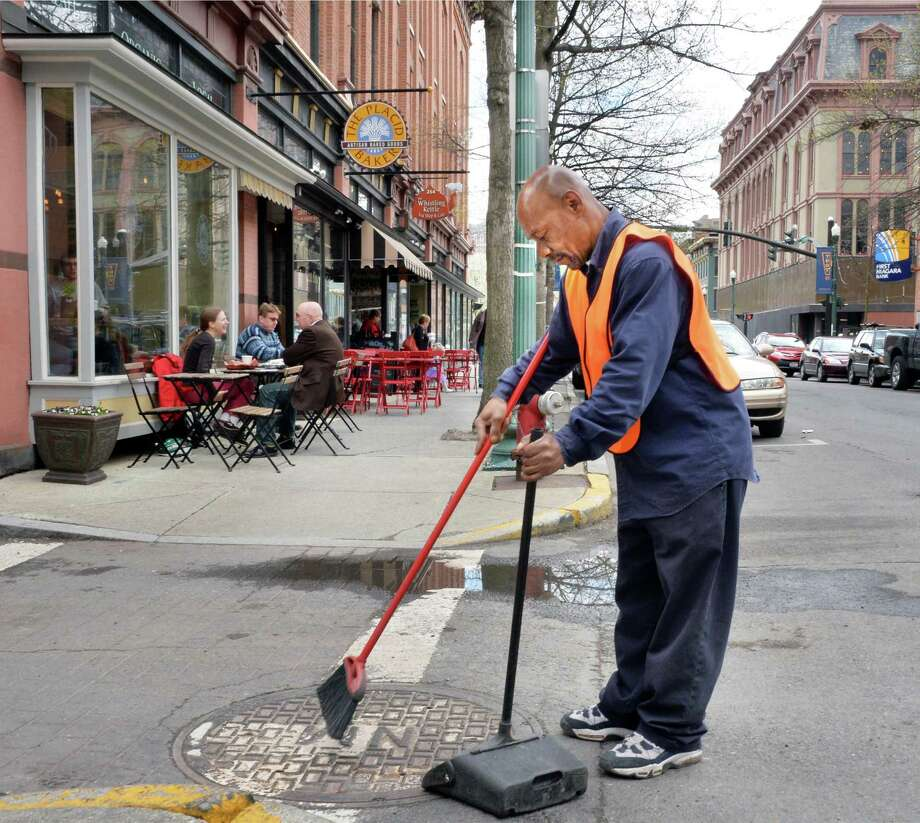 Troy Downtown Business Improvement District beautification street patrol employee Daryl Evans works along Broadway Friday, May 2, 2014, in Troy, N.Y.  (John Carl D'Annibale / Times Union) Photo: John Carl D'Annibale / 00026733A