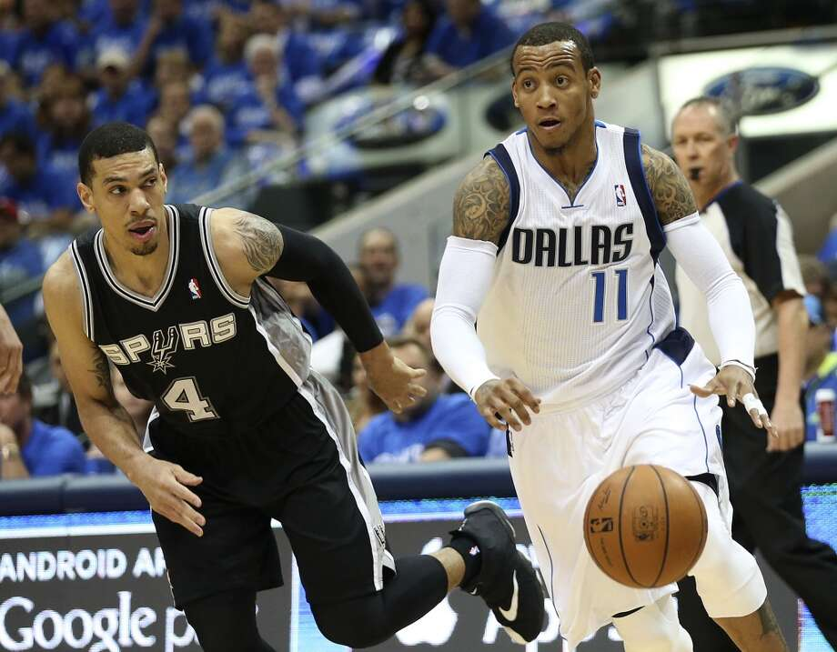 San Antonio Spurs' Danny Green chases after Dallas Mavericks' Monta Ellis during the first half of game six in the first round of the Western Conference Playoffs at the American Airlines Center in Dallas, Friday, May 2, 2014. Photo: San Antonio Express-News