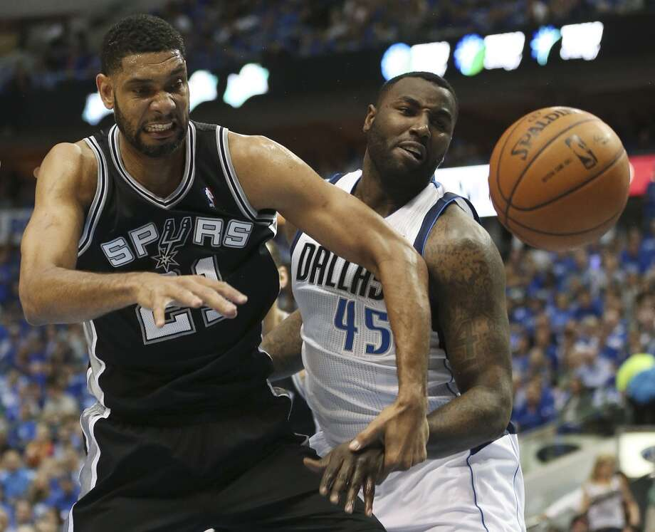 San Antonio Spurs' Tim Duncan and Dallas Mavericks' DeJuan Blair go for a rebound during the first half of game six in the first round of the Western Conference Playoffs at the American Airlines Center in Dallas, Friday, May 2, 2014. Photo: San Antonio Express-News
