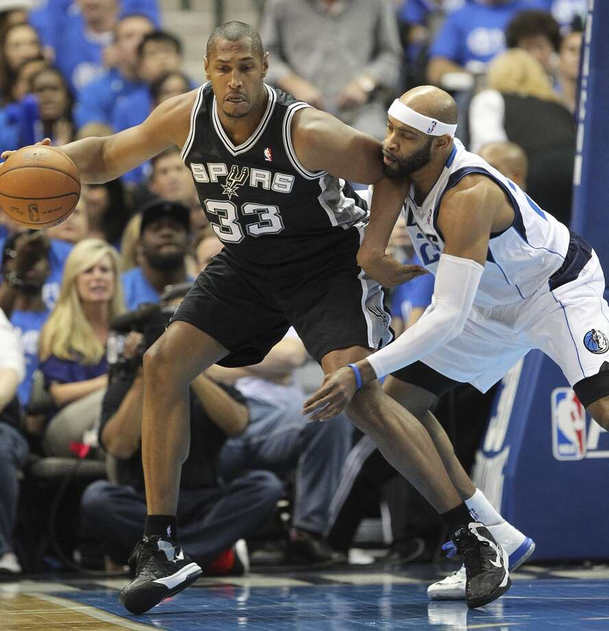 San Antonio Spurs' Boris Diaw keeps Dallas Mavericks' Vince Carter away from the ball during the first half of game six in the first round of the Western Conference Playoffs at the American Airlines Center in Dallas, Friday, May 2, 2014. Photo: San Antonio Express-News