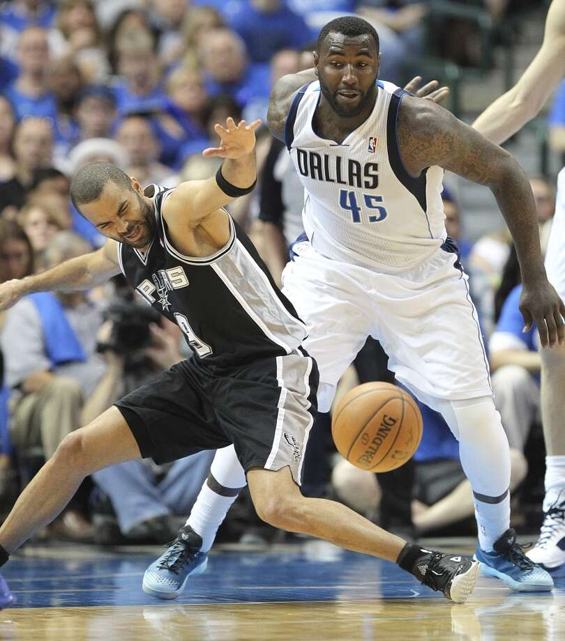San Antonio Spurs' Tony Parker loses the ball as Dallas Mavericks' DeJuan Blair defends during the first half of game six in the first round of the Western Conference Playoffs at the American Airlines Center in Dallas, Friday, May 2, 2014. Photo: San Antonio Express-News