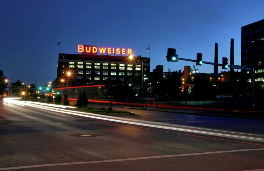 In this July 13, 2008 photo cars move near the Anheuser-Busch St. Louis brewery. August Busch III was CEO of Anheuser-Busch Companies for nearly three decades before his 2002 retirement, remaining as board chairman until 2006. The St. Louis brewer is being sued for gender discrimination by Francine Katz, who was the company's highest ranking female executive before her 2008 resignation. Katz says she was grossly underpaid compared to her male predecessor and other top male executives at the company. (AP Photo/St. Louis Post-Dispatch, David Carson) Photo: David Carson, MBO / St. Louis Post Dicpatch