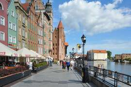 Poland's Gdansk is often a port of call on northern European cruises. These brick buildings line the city's atmospheric riverfront embankment.