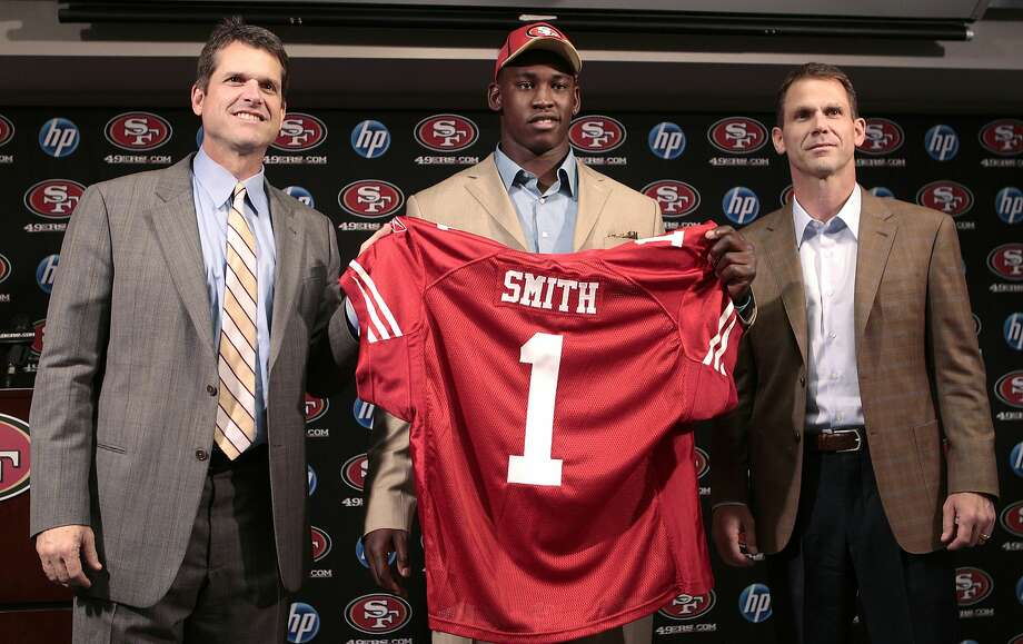 "When linebacker Aldon Smith was drafted, 49ers head coach Jim Harbaugh (left) said of him, ""I'm really impressed with him as a person, he's an all-American young man."" Photo: Jeff Chiu, Associated Press"