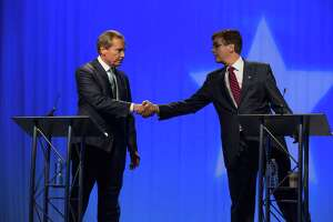Lieutenant Governor David Dewhurst, left, shakes hands with  State Senator Dan Patrick, right,  before their debate at Houston Public Media studios during the Republican Lieutenant Governor debate on Friday, May 2, 2014, in Houston. (AP Photo/Houston Chronicle, Eric Kayne)