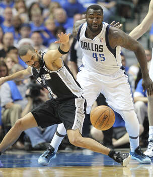 Tony Parker (Spurs-high 22 points) loses the ball in the first half as ex-teammate DeJuan Blair (game-high 14 rebounds) defends. Photo: Jerry Lara / San Antonio Express-News / ©2014 San Antonio Express-News