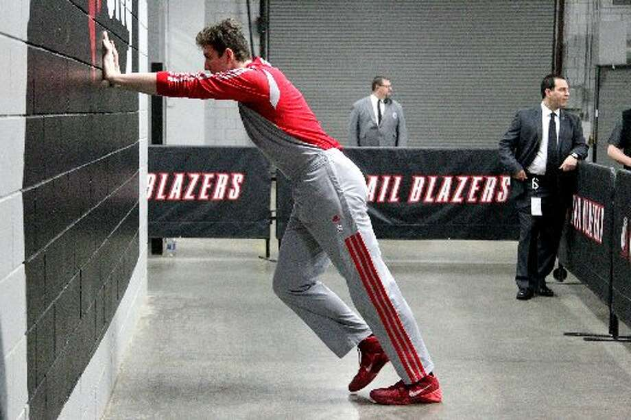 Rockets center Omer Asik stretches before Game 6. Photo: James Nielsen, Houston Chronicle
