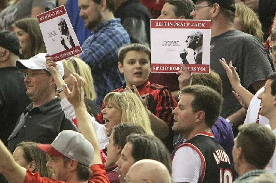 Trail Blazers fans honor former Blazers coach Dr. Jack Ramsay before Game 6. Photo: James Nielsen, Houston Chronicle