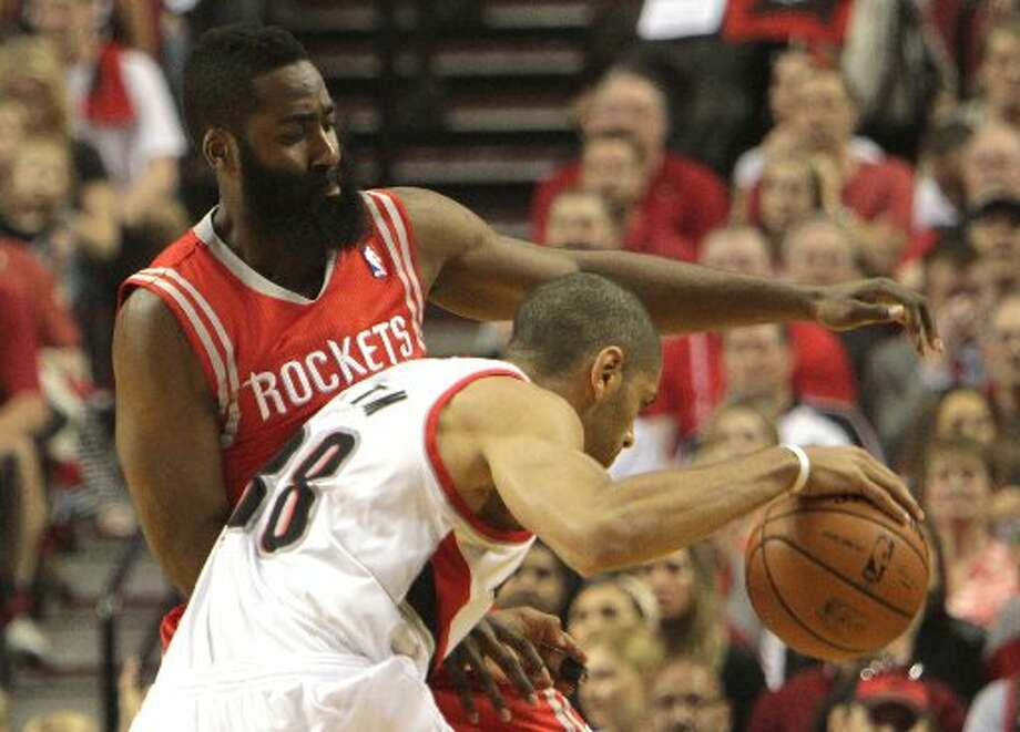 Rockets guard James Harden, left, defends a drive by Portland Trail Blazers forward Nicolas Batum (88) during the first quarter. Photo: James Nielsen, Houston Chronicle