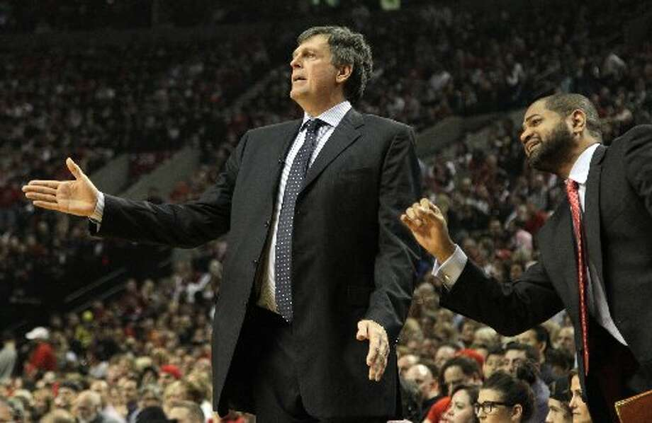 Rockets head coach Kevin McHale and assistant J.B. Bickerstaff call plays during Game 6. Photo: James Nielsen, Houston Chronicle