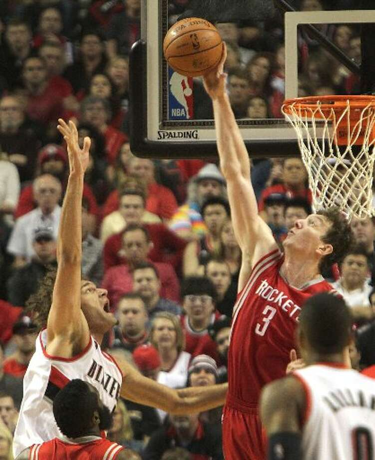 Rockets center Omer Asik (3) blocks a shot by Portland Trail Blazers center Robin Lopez (42) during the first quarter. Photo: James Nielsen, Houston Chronicle