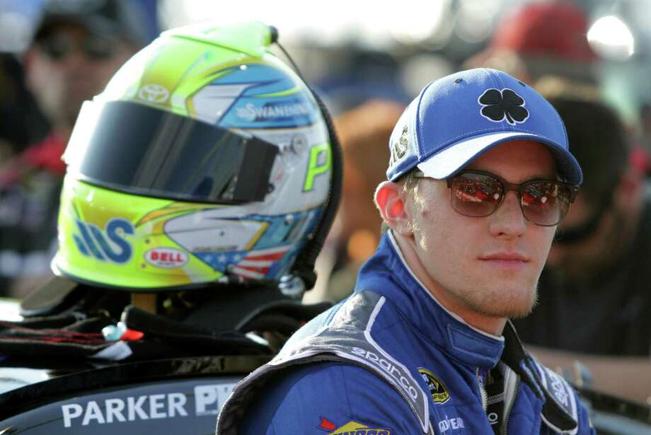 DARLINGTON, SC - APRIL 12:  Parker Kligerman, driver of the #30 SMS Audio Toyota, stands on the grid before the NASCAR Sprint Cup Series Bojangles' Southern 500 at Darlington Raceway on April 12, 2014 in Darlington, South Carolina. Photo: Jerry Markland, Getty Images / 2014 Getty Images