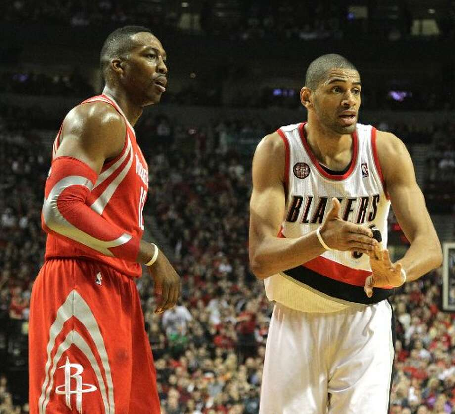 Trail Blazers forward Nicolas Batum (88) looks for a could call against Houston Rockets center Dwight Howard (12) during the first quarter. Photo: James Nielsen, Houston Chronicle