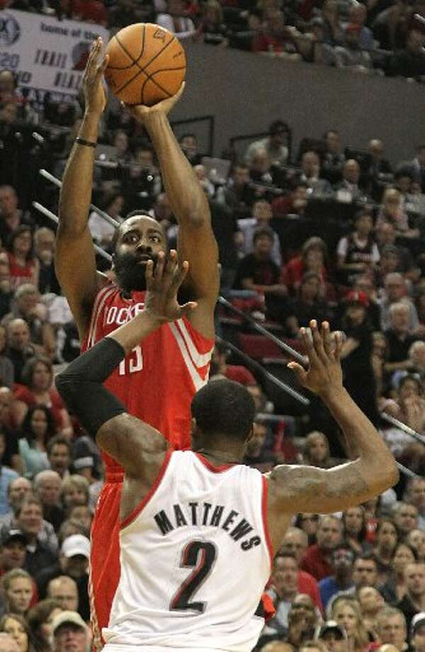 Rockets guard James Harden (13) shoots over Portland Trail Blazers guard Wesley Matthews (2) during the second quarter. Photo: James Nielsen, Houston Chronicle