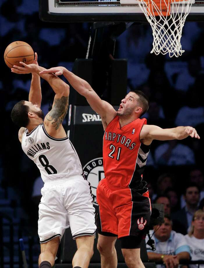 Toronto Raptors' Greivis Vasquez (21) fouls Brooklyn Nets' Deron Williams (8) during the first half of Game 6 of the opening-round NBA basketball playoff series Friday, May 2, 2014, in New York. (AP Photo/Frank Franklin II) ORG XMIT: NYFF105 Photo: Frank Franklin II / AP