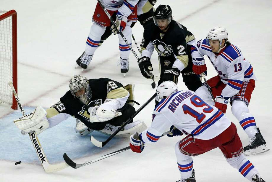 New York Rangers' Brad Richards (19) fires the puck past Pittsburgh Penguins goalie Marc-Andre Fleury (29) for a goal in the first period of Game 1 of a second-round NHL hockey playoff series in Pittsburgh, Friday, May 2, 2014. (AP Photo/Gene J. Puskar) ORG XMIT: PAGP101 Photo: Gene J. Puskar / AP