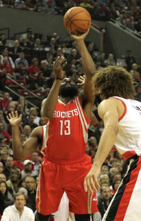 Houston Rockets guard James Harden (13) takes a shot over Portland Trail Blazers center Robin Lopez (42) during the first quarter of game six of the Western Conference Quarterfinals playoffs at the Moda Center Friday, May 2, 2014, in Portland. ( James Nielsen / Houston Chronicle ) Photo: James Nielsen, Staff / © 2014  Houston Chronicle
