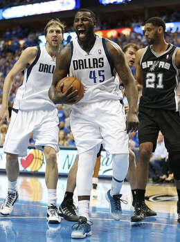 Ex-Spur DeJuan Blair (45) returned from a one-game suspension to score 10 points and grab a game-high 14 rebounds for Dallas. Dirk Nowitzki (left) finished with 22 points, while Tim Duncan had 16 points. Photo: Jerry Lara / San Antonio Express-News / ©2014 San Antonio Express-News