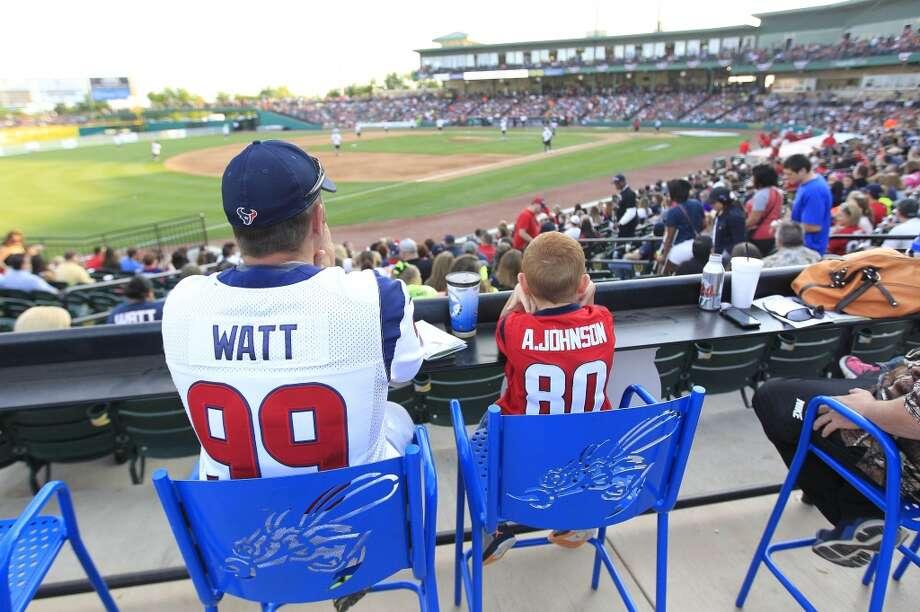 Fans wear Texans jerseys during the home run derby. Photo: Karen Warren, Houston Chronicle