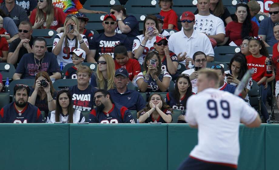 Fans take pictues of J.J. Watt at bat during the home run derby before the softball game Photo: Karen Warren, Houston Chronicle