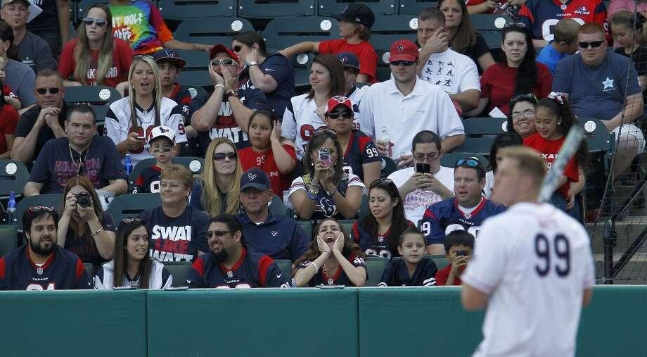 Fans take pictues of J.J. Watt at bat during the home run derby before the softball game Photo: Karen Warren, Houston Chronicle