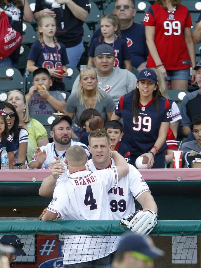 J.J. Watt hugs his friend Trey Brandt during the home run derby before the softball game. Photo: Karen Warren, Houston Chronicle