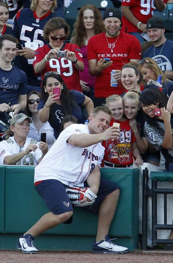 J.J. Watt takes a selfie with fans during the home run derby . Photo: Karen Warren, Houston Chronicle