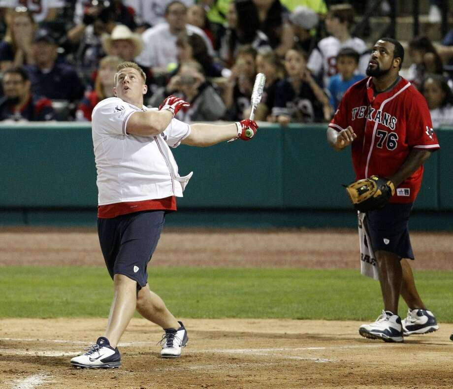 J.J. Watt at bat during the game. Photo: Karen Warren, Houston Chronicle