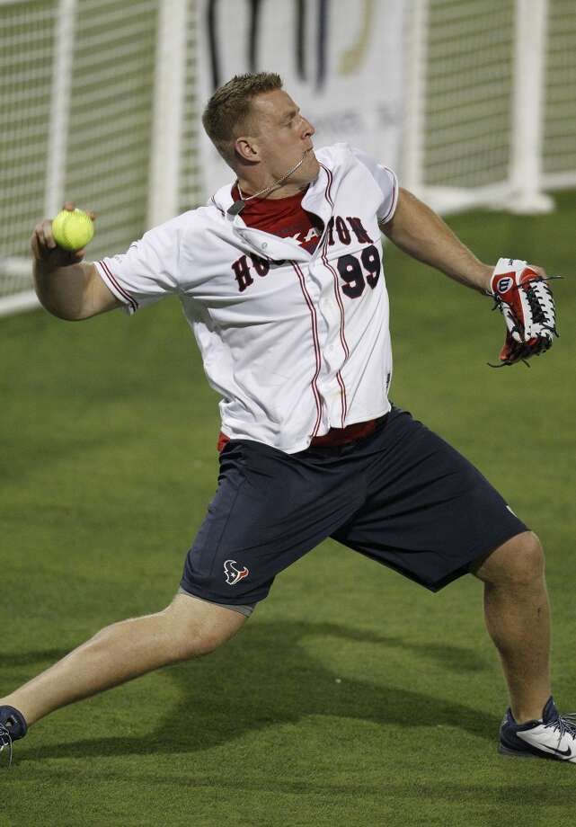 J.J. Watt throws the ball from left field. Photo: Karen Warren, Houston Chronicle
