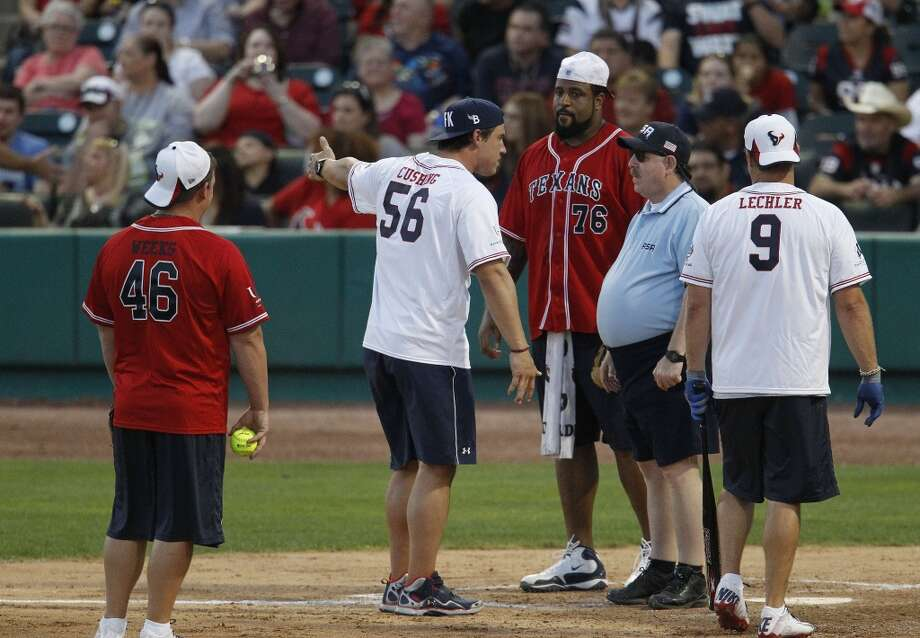 Brian Cushing stops the game to argue that the Offense had too many players on the field during the softball game. Photo: Karen Warren, Houston Chronicle
