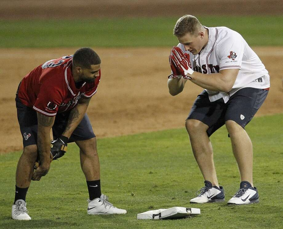 J.J. Watt bows to Arian Foster as he rounds second base after Watt's home run during the softball game. Photo: Karen Warren, Houston Chronicle