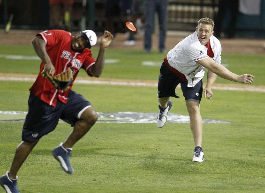 J.J. Watt throws water balloons at Andre Johnson during the softball game. Photo: Karen Warren, Houston Chronicle