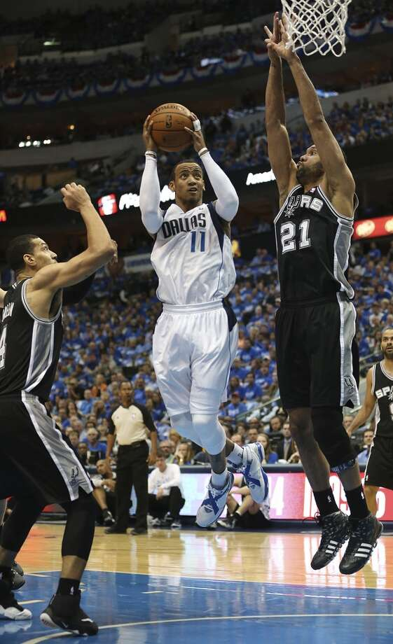 Dallas Mavericks' Monta Ellis goes between San Antonio Spurs' Danny Green and Tim Duncan during the first half of game six in the first round of the Western Conference Playoffs at the American Airlines Center in Dallas, Friday, May 2, 2014. Photo: San Antonio Express-News