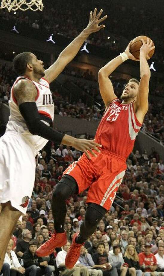 Rockets forward Chandler Parsons (25) takes a shot against the Portland Trail Blazers during the second quarter. Photo: James Nielsen, Houston Chronicle