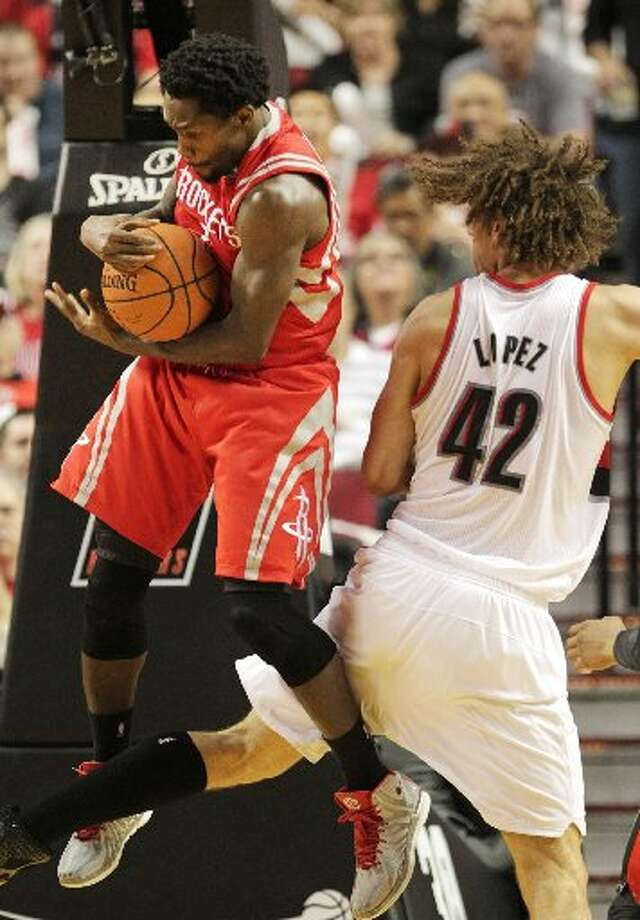 Rockets guard Patrick Beverley (2) pulls down a rebound from Portland Trail Blazers center Robin Lopez (42) during the third quarter. Photo: James Nielsen, Houston Chronicle