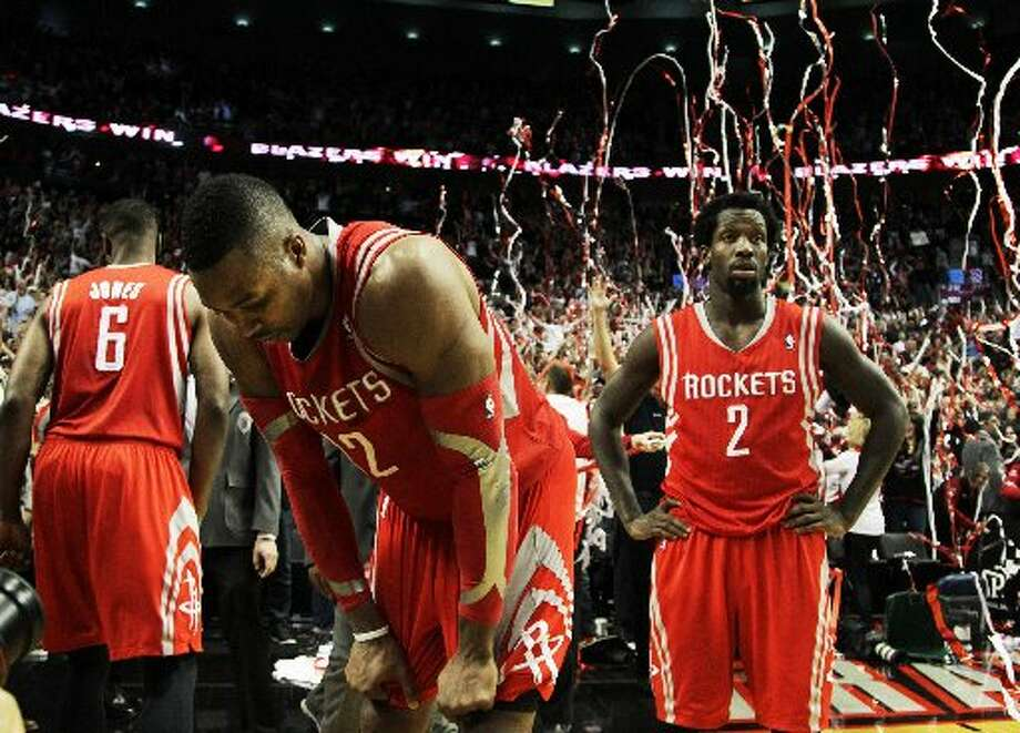 May 2 - Game 6: Trail Blazers 99, Rockets 98  (Portland wins series 4-2)  Rockets center Dwight Howard and guard Pat Beverley react to losing on a last-second shot by Trail Blazers guard Damian Lillard. Photo: James Nielsen, Houston Chronicle