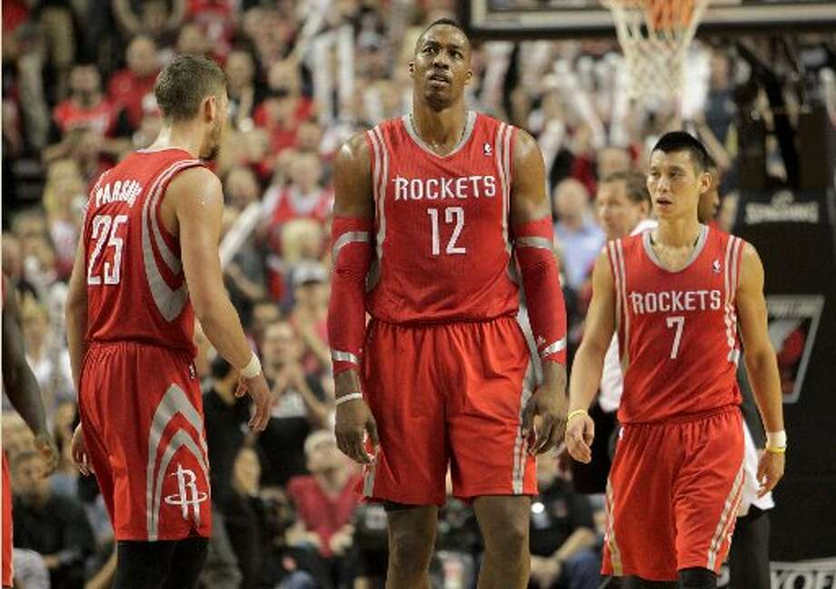 Rockets forward Chandler Parsons (25), center Dwight Howard (12) and guard Jeremy Lin (7) walk up court during the fourth quarter. Photo: James Nielsen, Houston Chronicle