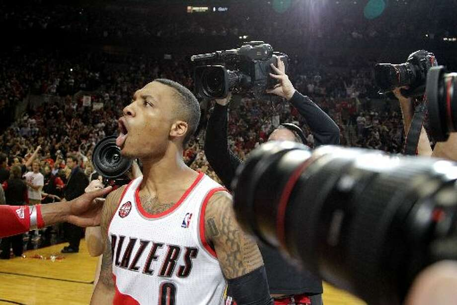 Trail Blazers guard Damian Lillard celebrates his game-winning shot over the Houston Rockets during the fourth quarter. Photo: James Nielsen, Houston Chronicle