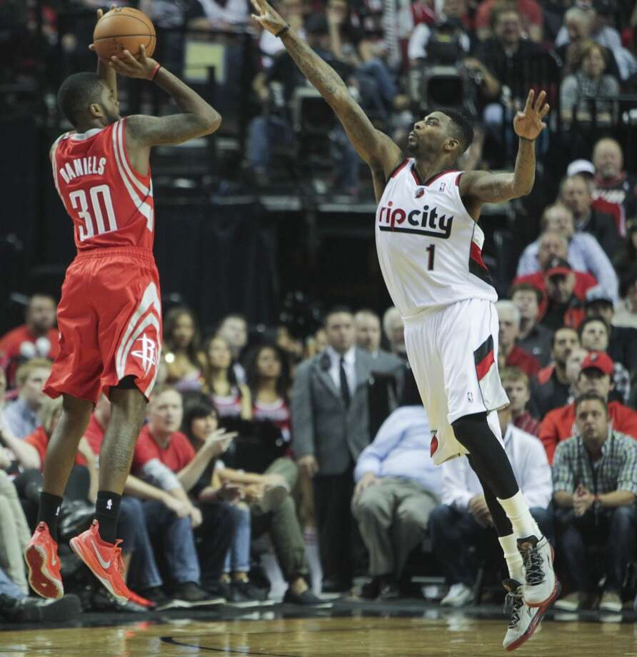 April 25: Rockets 121, Blazers 116 (OT)  Troy Daniels hit a 3-pointer with 11 seconds left in overtime to help the Rockets beat the Blazers.  Series record: Portland leads 2-1 Photo: James Nielsen, Houston Chronicle