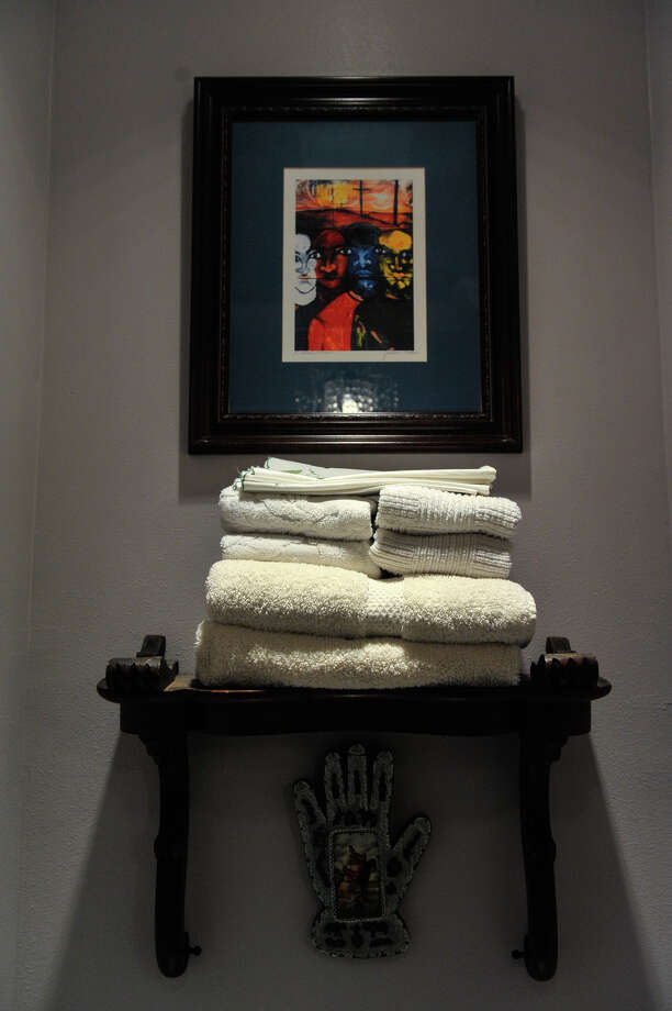 A towel shelf with art in the home of Ruthie Foultz. Photo: Robin Jerstad