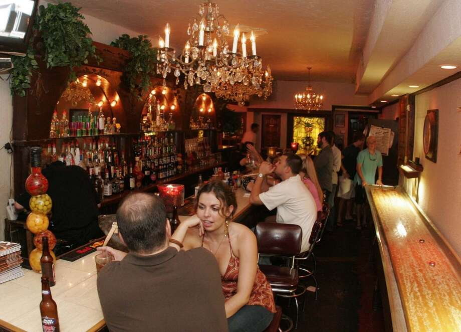 Leon's Lounge1006 McGowen 713-659-5366  Old school vibe and fine bartenders make this charming Midtown spot a place for lingering. Perfect for hooking up with that old girlfriend. Photo: Bill Olive, For The Chronicle