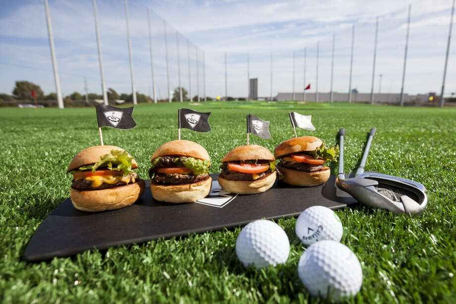 TopGolf  1030 Memorial Brook Blvd.  281-406-3176  560 Springs Park Center, in Spring 832-200-0106  This entertainment complex is one part upscale sports bar and one part driving range. At 70,000 square feet, it is is is easily is Houston's largest sports bar, but to call it just another sports bar might be an insult. It has a rooftop terrace with fire pits, several lounges and bars and a from-scratch kitchen.   [Photo: The American Cheeseburger Sliders at TopGolf.] Photo: Michael Paulsen, Houston Chronicle
